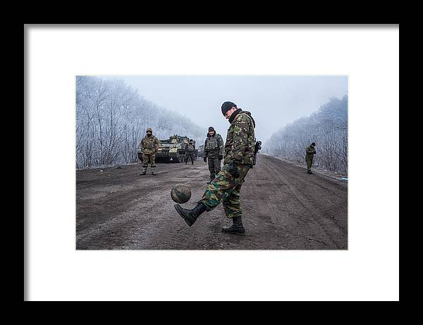 2014 Russian Military Intervention In Ukraine Framed Print featuring the photograph A Ceasefire Is Brokered In War Torn Eastern Ukraine by Brendan Hoffman