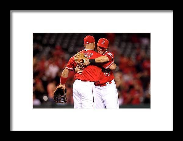 American League Baseball Framed Print featuring the photograph Albert Pujols by Stephen Dunn