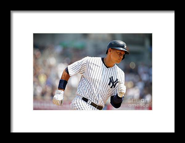 People Framed Print featuring the photograph Alex Rodriguez, Eric Hosmer, and Chris Young by Al Bello
