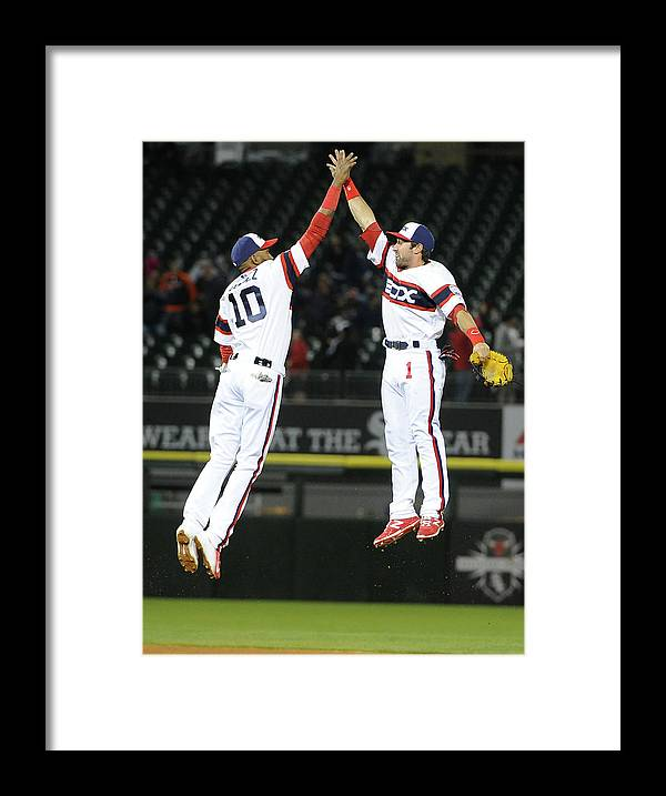 People Framed Print featuring the photograph Alexei Ramirez and Adam Eaton by David Banks