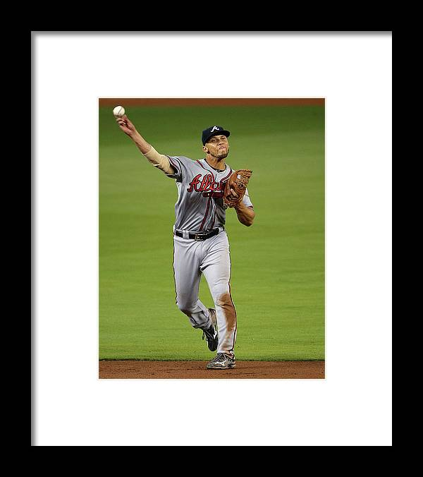 People Framed Print featuring the photograph Andrelton Simmons by Mike Ehrmann