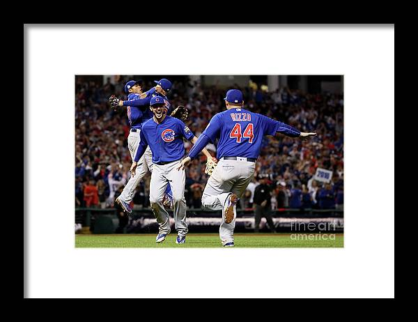 People Framed Print featuring the photograph Anthony Rizzo and Kris Bryant by Ezra Shaw