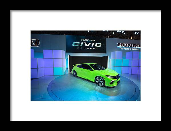 Concepts & Topics Framed Print featuring the photograph Automakers Showcase New Models At New York International Auto Show by Kevin Hagen