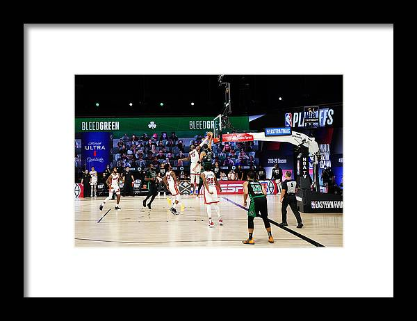 Playoffs Framed Print featuring the photograph Bam Adebayo and Jayson Tatum by Jesse D. Garrabrant