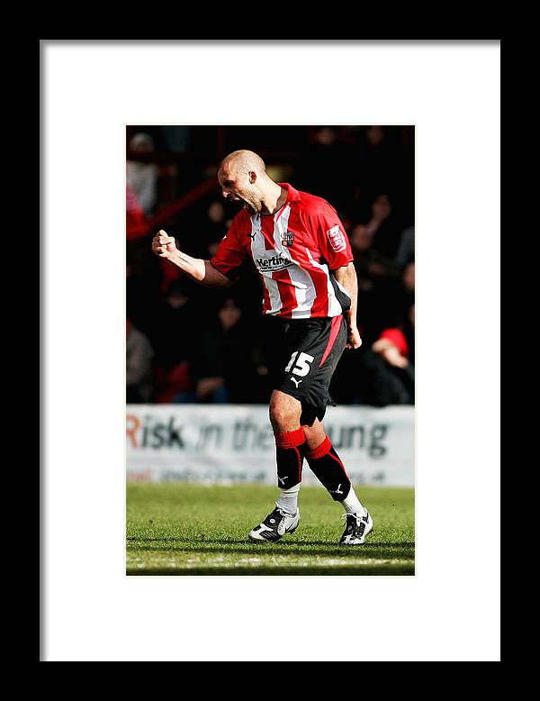 Scoring Framed Print featuring the photograph Brentford v Gillingham by Dean Mouhtaropoulos