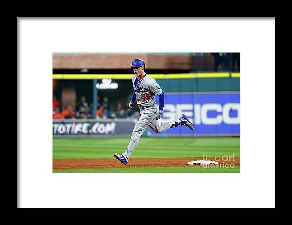 People Framed Print featuring the photograph Cody Bellinger by Jamie Squire