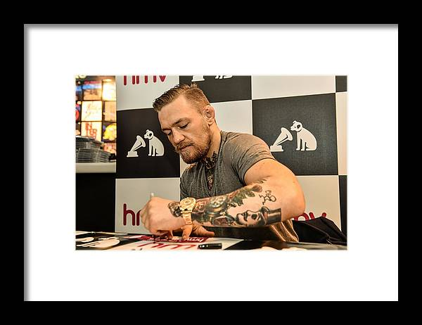 Dvd Framed Print featuring the photograph Conor McGregor DVD Signing by Sportsfile