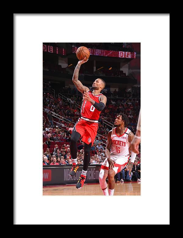Nba Pro Basketball Framed Print featuring the photograph Damian Lillard by Bill Baptist