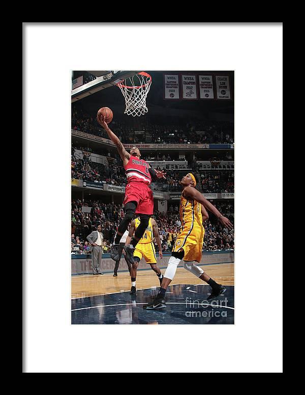 Nba Pro Basketball Framed Print featuring the photograph Damian Lillard by Ron Hoskins