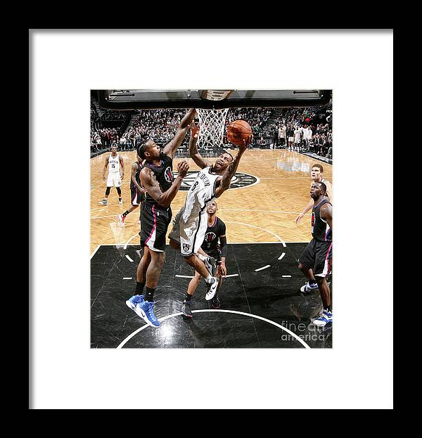 Nba Pro Basketball Framed Print featuring the photograph Deandre Jordan and Sean Kilpatrick by Nathaniel S. Butler