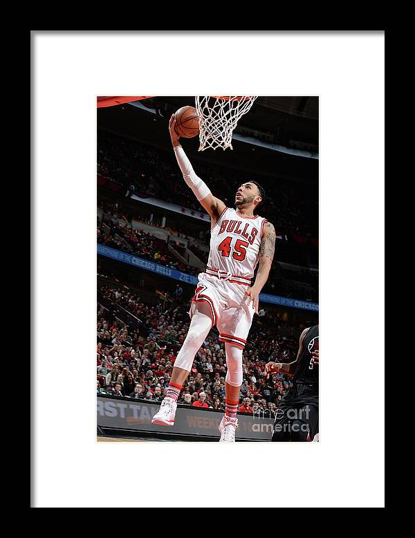Nba Pro Basketball Framed Print featuring the photograph Denzel Valentine by Randy Belice