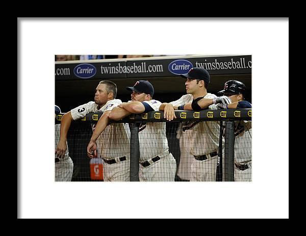 Joe Mauer Framed Print featuring the photograph Detroit Tigers v Minnesota Twins by Hannah Foslien