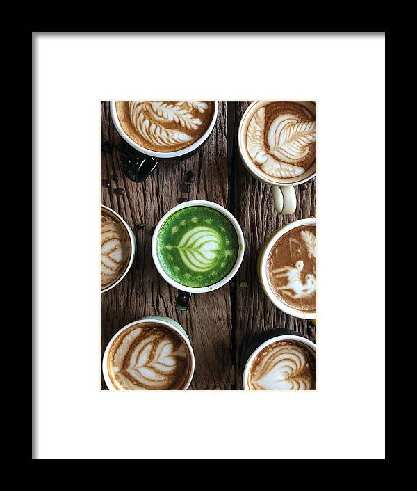 Art Framed Print featuring the photograph Directly Above Shot Of Coffee With Froth Art On Table by Pakorn Polachai / EyeEm