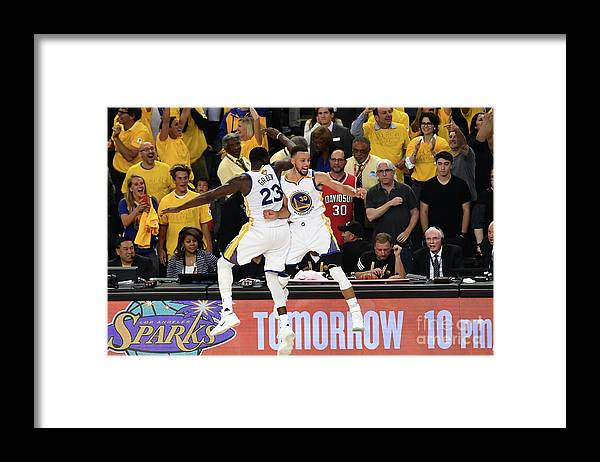 Playoffs Framed Print featuring the photograph Draymond Green and Stephen Curry by Garrett Ellwood