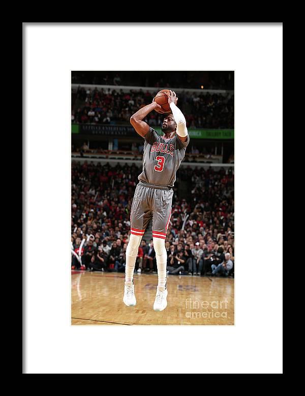 Nba Pro Basketball Framed Print featuring the photograph Dwyane Wade by David Sherman