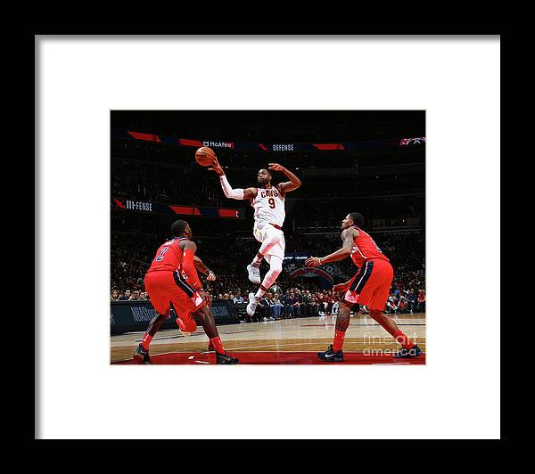 Nba Pro Basketball Framed Print featuring the photograph Dwyane Wade by Ned Dishman