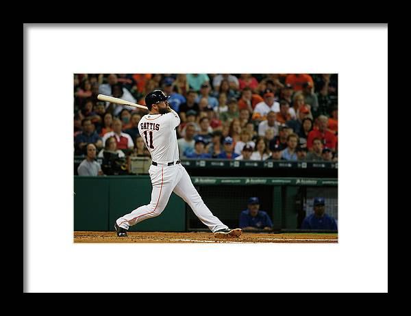 Evan Gattis Framed Print featuring the photograph Evan Gattis by Scott Halleran