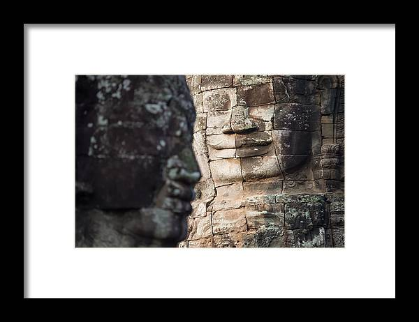 Relief Carving Framed Print featuring the photograph face of Bhudha at Bayon temple by Skaman306
