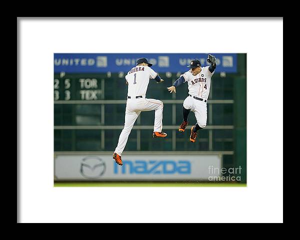 American League Baseball Framed Print featuring the photograph George Springer and Carlos Correa by Bob Levey