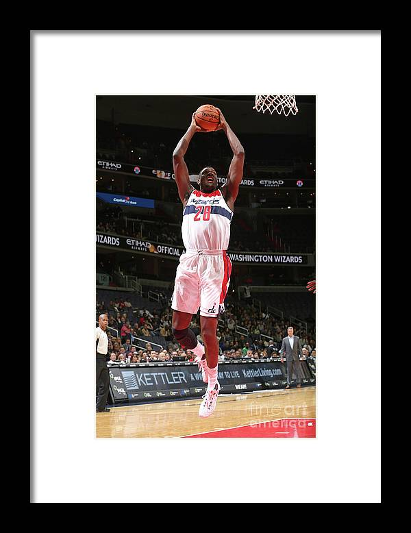 Nba Pro Basketball Framed Print featuring the photograph Ian Mahinmi by Ned Dishman