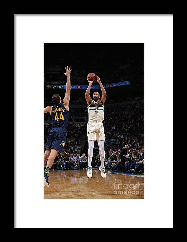 Nba Pro Basketball Framed Print featuring the photograph Jabari Parker by Gary Dineen
