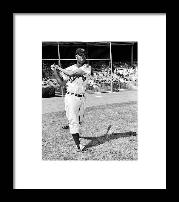 People Framed Print featuring the photograph Jackie Robinson and Larry Doby by Kidwiler Collection