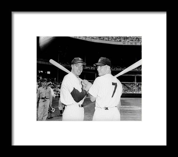 American League Baseball Framed Print featuring the photograph Joe Dimaggio and Mickey Mantle by New York Daily News Archive