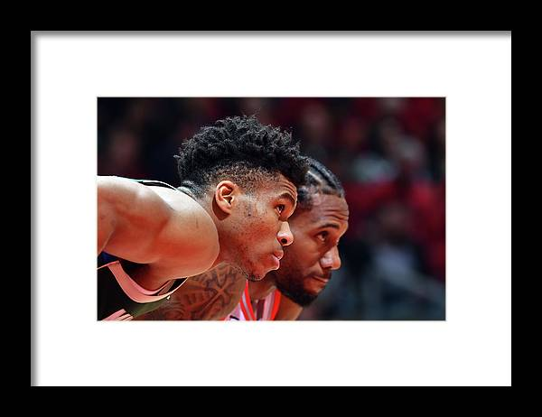 Playoffs Framed Print featuring the photograph Kawhi Leonard and Giannis Antetokounmpo by Jesse D. Garrabrant