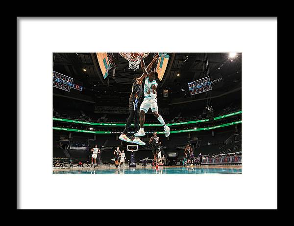 Nba Pro Basketball Framed Print featuring the photograph Kevin Durant and Terry Rozier by Kent Smith