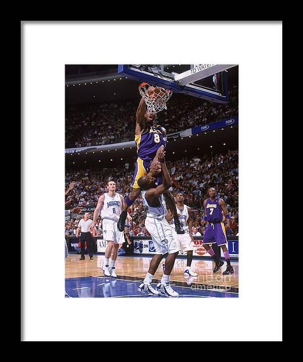Nba Pro Basketball Framed Print featuring the photograph Kobe Bryant and Dwight Howard by Fernando Medina