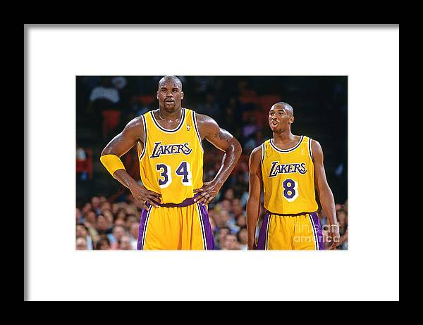 Nba Pro Basketball Framed Print featuring the photograph Kobe Bryant and Shaquille O'neal by Andrew D. Bernstein