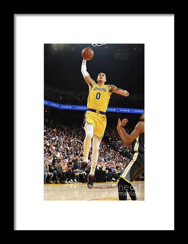 Nba Pro Basketball Framed Print featuring the photograph Kyle Kuzma by Garrett Ellwood