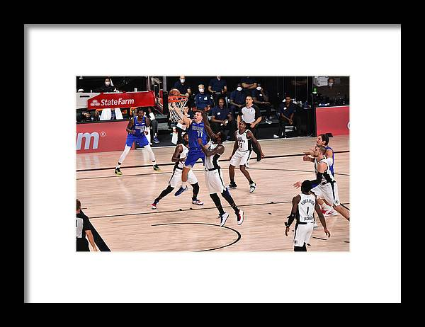 Playoffs Framed Print featuring the photograph LA Clippers v Dallas Mavericks - Game Three by David Dow