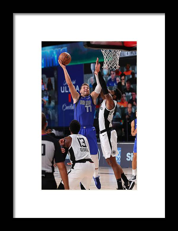 Playoffs Framed Print featuring the photograph LA Clippers v Dallas Mavericks - Game Three by Joe Murphy