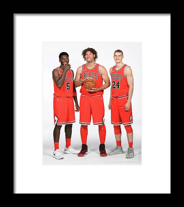 Media Day Framed Print featuring the photograph Lauri Markkanen, Bobby Portis, and Robin Lopez by Randy Belice