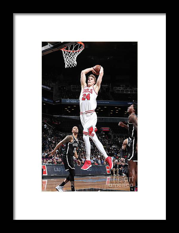 Chicago Bulls Framed Print featuring the photograph Lauri Markkanen by Nathaniel S. Butler