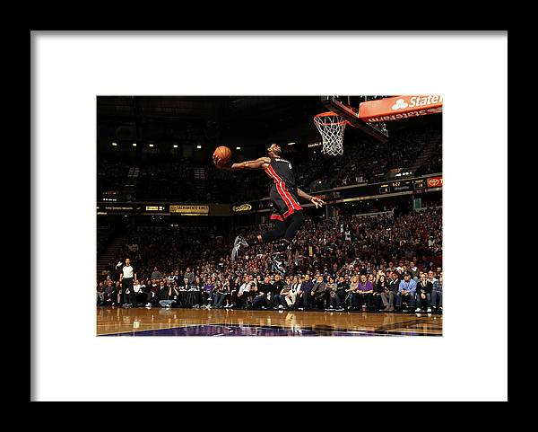 Nba Pro Basketball Framed Print featuring the photograph Lebron James by Ezra Shaw