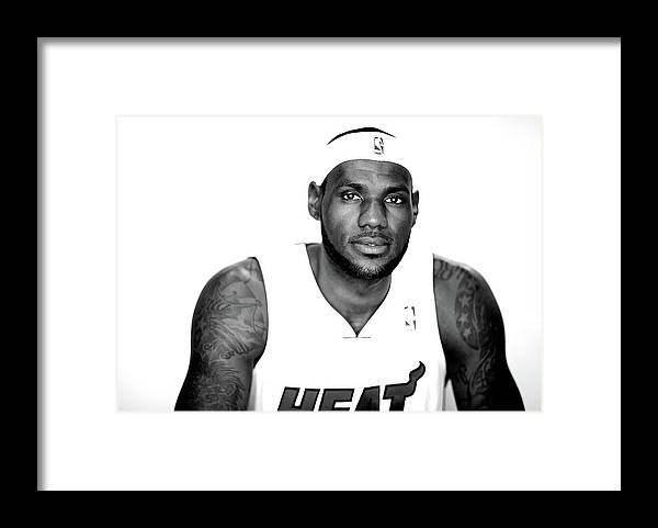 Nba Pro Basketball Framed Print featuring the photograph Lebron James by Mike Ehrmann
