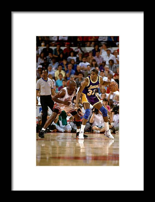 Nba Pro Basketball Framed Print featuring the photograph Magic Johnson and Michael Jordan by Andrew D. Bernstein