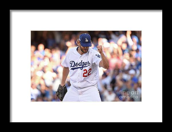 Three Quarter Length Framed Print featuring the photograph Manny Machado and Clayton Kershaw by Kevork Djansezian