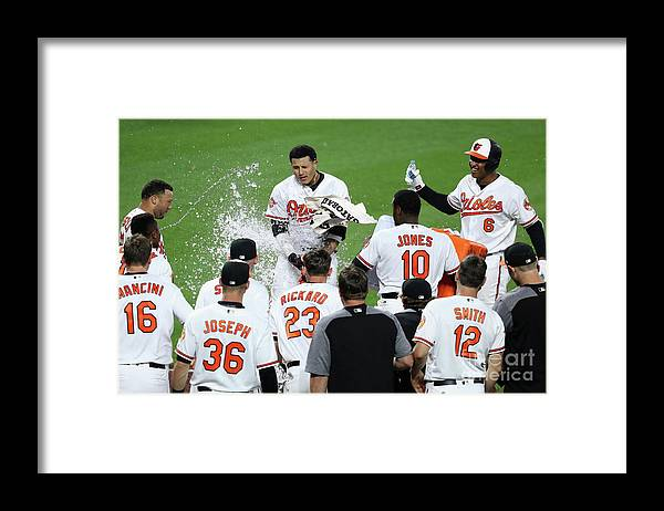 People Framed Print featuring the photograph Manny Machado, Jonathan Schoop, and Adam Jones by Rob Carr