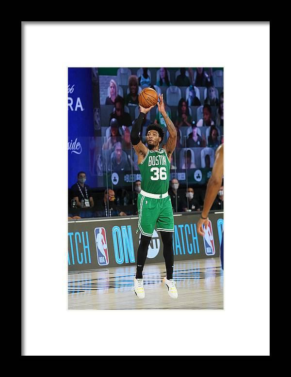 Playoffs Framed Print featuring the photograph Marcus Smart by Jesse D. Garrabrant