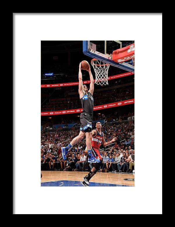 Nba Pro Basketball Framed Print featuring the photograph Mario Hezonja by Gary Bassing