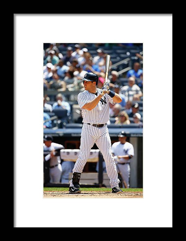 People Framed Print featuring the photograph Mark Teixeira by Al Bello