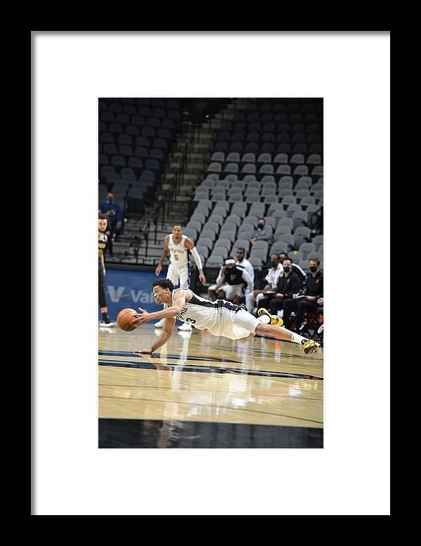 Keldon Johnson Framed Print featuring the photograph Memphis Grizzlies v San Antonio Spurs by Logan Riely