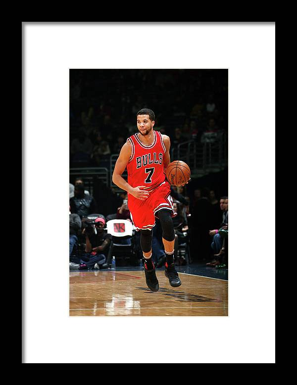 Nba Pro Basketball Framed Print featuring the photograph Michael Carter-williams by Ned Dishman