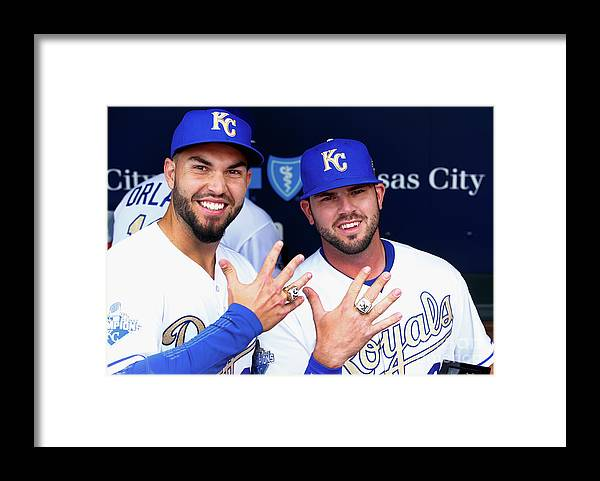 People Framed Print featuring the photograph Mike Moustakas and Eric Hosmer by Jamie Squire