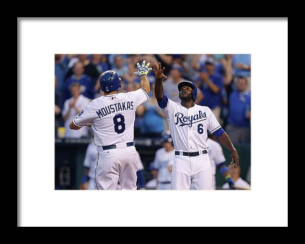American League Baseball Framed Print featuring the photograph Mike Moustakas and Lorenzo Cain by Ed Zurga