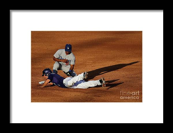 Game Two Framed Print featuring the photograph Nick Hundley and Jimmy Rollins by Doug Pensinger