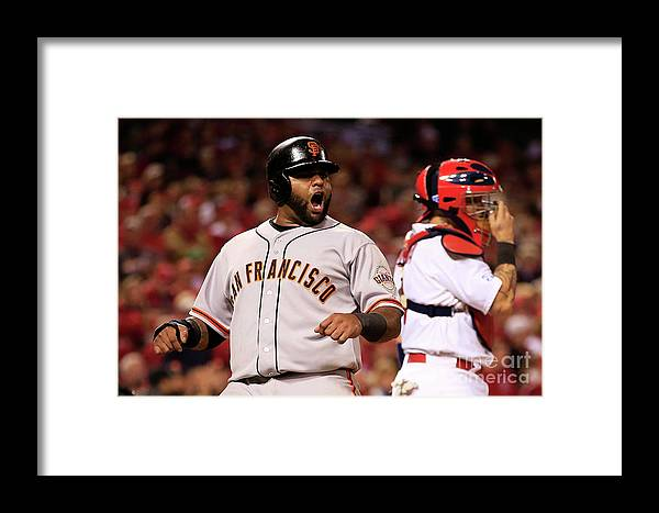 Game Two Framed Print featuring the photograph Pablo Sandoval, Yadier Molina, And Hunter Pence by Jamie Squire
